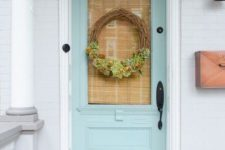 a vine wreath with blooms and greenery, heirloom pumpkins and fall blooms in baskets for a Thanksgiving feel