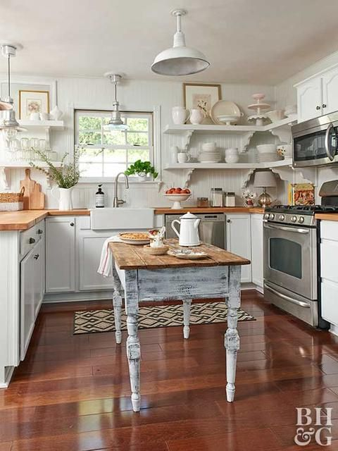 a welcoming cottage kitchen with shaker cabinets, butcherblock countertops, a beadboard backsplash, pendant lamps and a shabby chic table