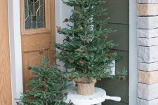 pretty Christmas trees with pinecones, a wire basket with pinecones for a strong natural or rustic feel in the space