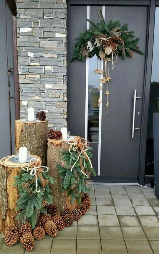 tree stumps with pinecones, fir hangings, candles and a pinecones hanging with stars, ribbons and bows for a rustic feel