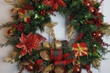 a beautiful Christmas wreath of evergreens, with poinsettia, gift boxes and ribbon bows plus ornaments