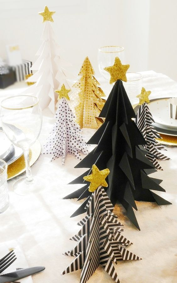 a black and white Christmas trees and gold ones with various patterns and gold glitter star toppers for holiday decor