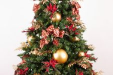 a bold red and gold Christmas tree with bows, gilded foliage, large gold ornaments