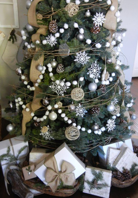 a farmhouse Christmas tree with snowball garlands, burlap ribbons, pinecones, greenery and silver ornaments is a lovely idea