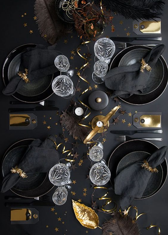a lovely Christmas tablescape with black plates and chargers, black linens and gold touches for ultimate elegance