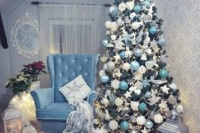a pretty and glam Christmas tree with white, silver, tiffany blue ornaments and beads and a star topper is chic and cool
