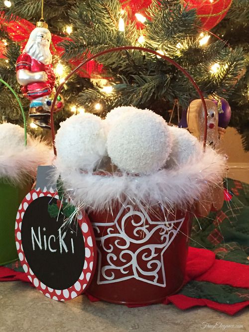 a red snowflake bucket with fluffy snowballs and a sign is a lovely decoration for Christmas and it looks very fun