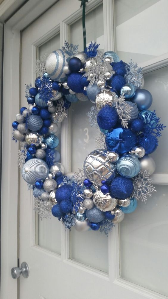a super bold Christmas wreath in silver, light and bold blue, with snowflakes and beads is a lovely and bright idea