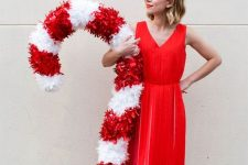 an oversized candy cane can be used as a decoration for indoors or outdoors and is amazing and bold