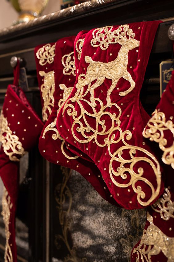 deep red and gold stockings with deer appliques and rhinestones are amazing for Christmas decor