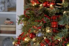 gold bells, red ornaments, plaid ribbons and red berries for Christmas tree decor