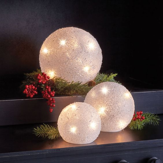 large snowball Christmas lights with berries and fir branches is a creative and cute decor idea for holidays