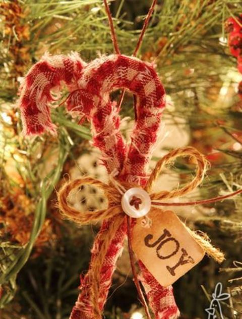 simple rustic Christmas ornaments - plaid candy canes with buttons, twine bows and a tag are amazing for your holiday decor