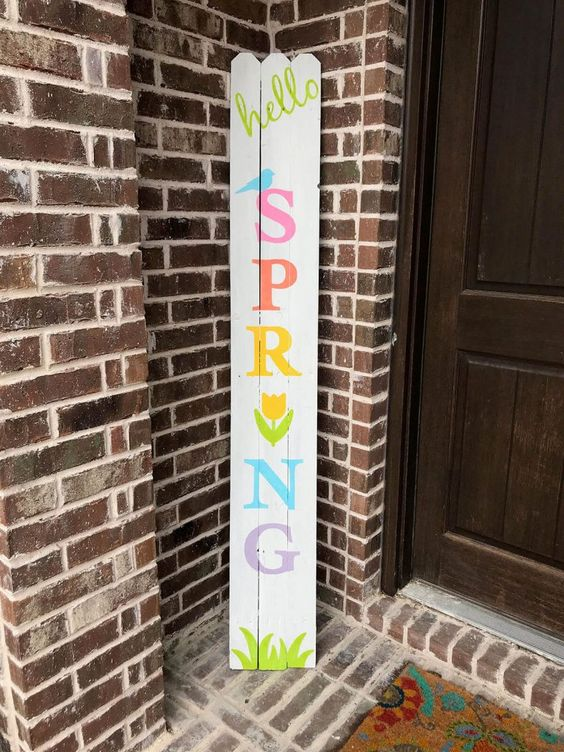 a colorful spring sign with grass, birdies and a bloom is fun and easy to make yourself