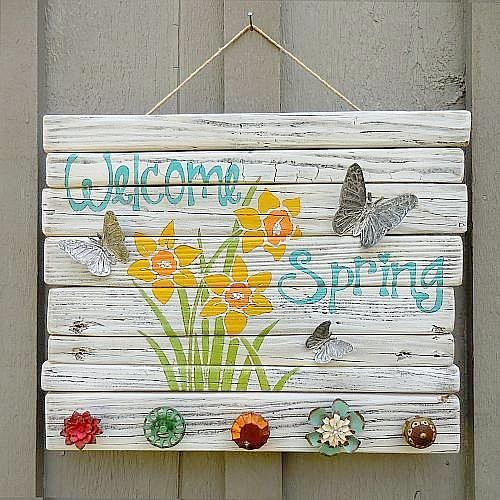 a colorful vintage spring sign with bold blooms and letters, with vintage knobs and butterflies is cool