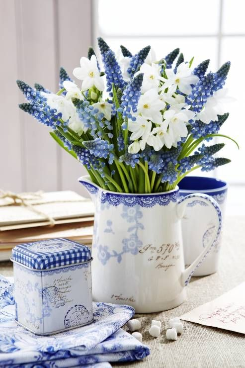 a jug with white crocus and blue hyacinths is a lovely and fresh spring flower arrangement is a beautiful idea
