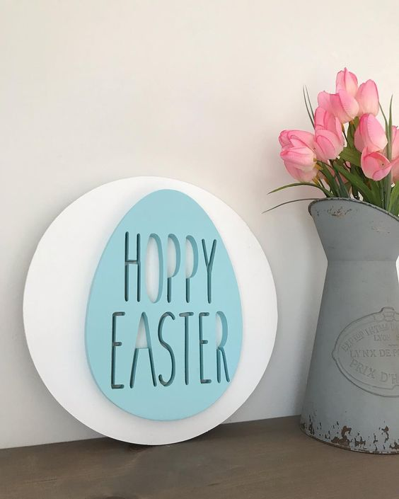 a modern and creative spring sign - a white circle with a blue Easter egg is a lovely and fun idea to rock