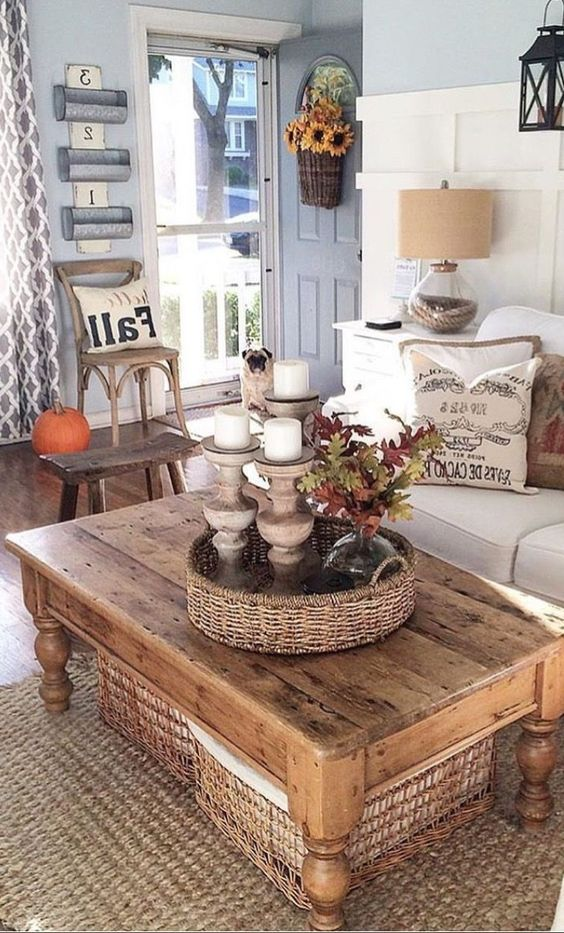 a rustic wooden coffee table with woven baskets for storing smaller things