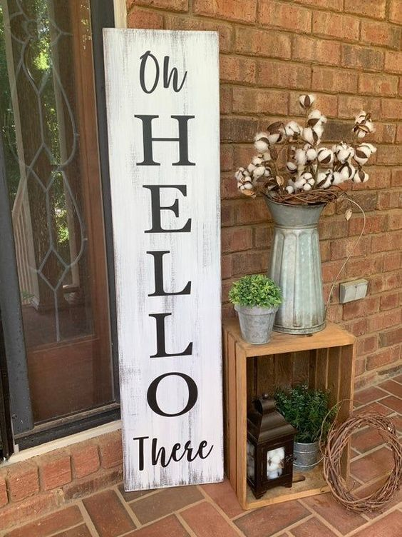 a shabby chic wooden plaque sign done with paint and stencils is a lovely idea for a rustic space