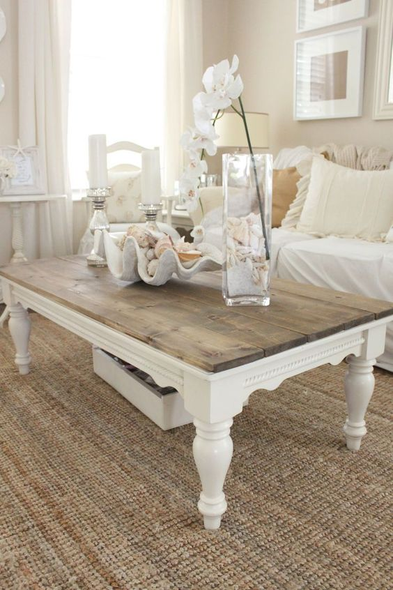 an elegant low farmhouse coffee table and a low drawer under it to store some small stuff