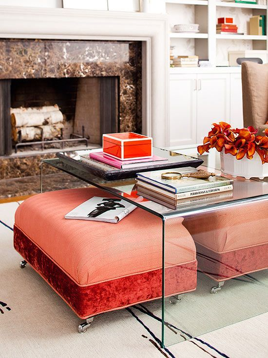 bright coral and red ottomans placed under an acrylic coffee table will be clearly seen and can be taken from there when needed