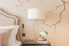 cherry blossom decals on the wall of your bedroom will make the space feel like spring and romance