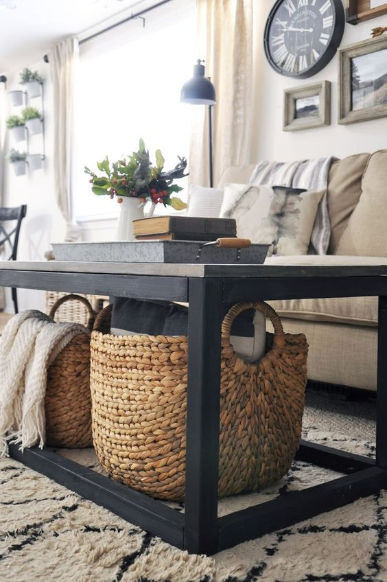 large rattan baskets placed under the table will save you some floor space and you can store blankets there
