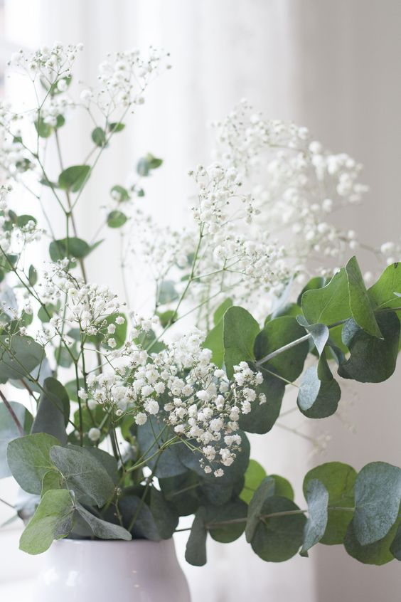 white baby's breath and eucalyptus is a fresh spring-like arrangement that will make any space amazing