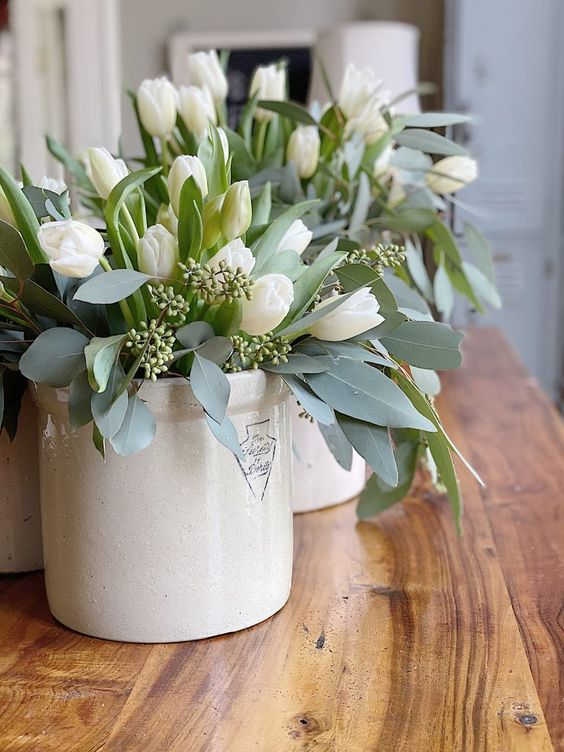 white vases with white tulips and eucalyptus are classics for spring and they will refresh your space at once