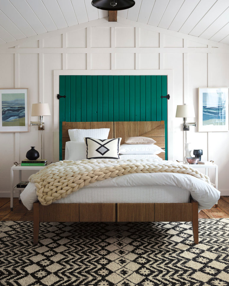 a mid-century modern meets farmhouse bedroom with white wooden panels, a bright emerald headboard, a printed rug  (Serena & Lily)