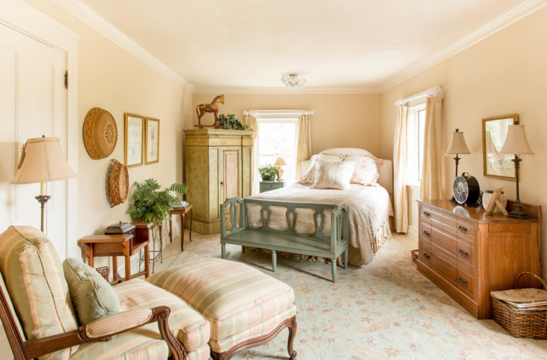 a cozy and welcoming farmhouse bedroom done in neutral shades, vintage furniture and printed textiles (Rikki Snyder)