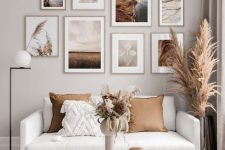 a beautiful nature-inspired gallery wall in light stained frames is a lovely decor idea to rock