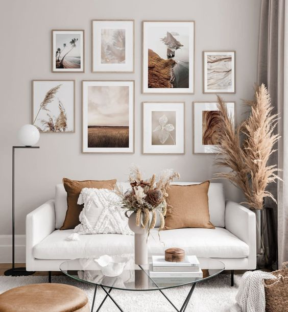 a beautiful nature inspired gallery wall in light stained frames is a lovely decor idea to rock