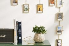 a chain with picture frames and photos in them is a creative and out-of-the-box display idea for your home