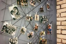 a creative wall mural of yarn with color and black and white photos attached to it here and there is super cool