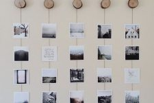 a nature-inspired gallery wall with Insta pics hanging on yarn from wood slice hooks is a cool idea