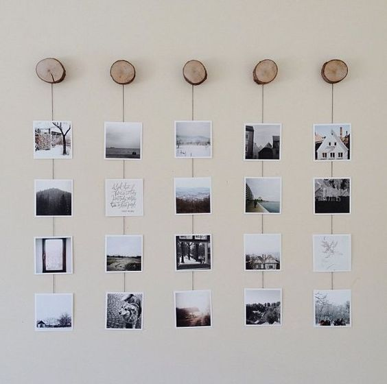 a nature inspired gallery wall with Insta pics hanging on yarn from wood slice hooks is a cool idea