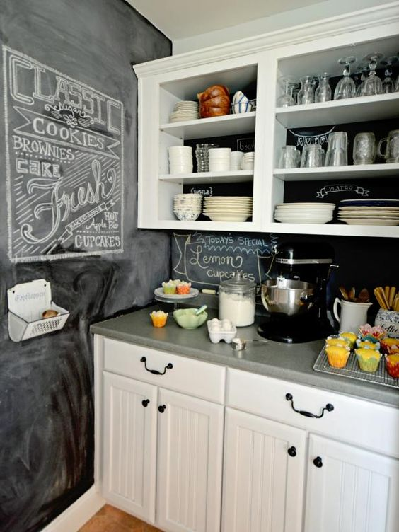 a neutral farmhouse kitchen with a chalkboard wall and backsplash is a stylish space to be and it feels very cozy and inviting