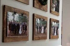 a rustic gallery wlal with photos attached to wooden planks is a stylish and cozy idea of decor