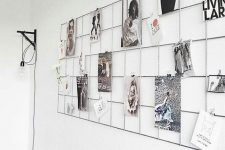 a simple metal grid on the wall will allow you to attach any photos you want to it and change them anytime