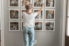 a stylish family gallery wall with color photos in matching white frames is a timeless idea