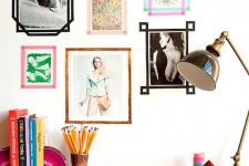 a washi tape gallery wall with pics attached right to it and surrounded with colorful washi tape