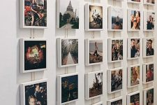 an Instagram gallery wall with photos on white cubes is a very stylish and modern idea to go for
