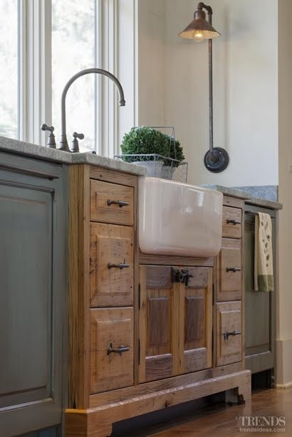 an interesting idea to make farmhouse kitchen cabinets stand out 35 Cozy And Chic Farmhouse Kitchen D cor Ideas  DigsDigs