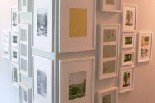 cover an awkward corner with a gallery wall with photos in matching white frames to make the use of it