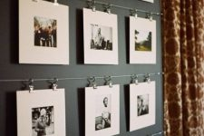 metal rails attached to the wall allow you attaching as many pics as you want and change them anytime