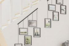 two photo rails attached to the staircase and photos hanging on them will let you comfortably show off your pics