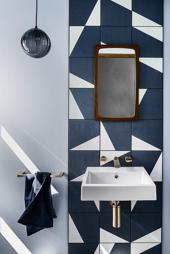 a catchy navy and white tile backsplash is a bold solution for any bathroom and it can be rocked in any modern space