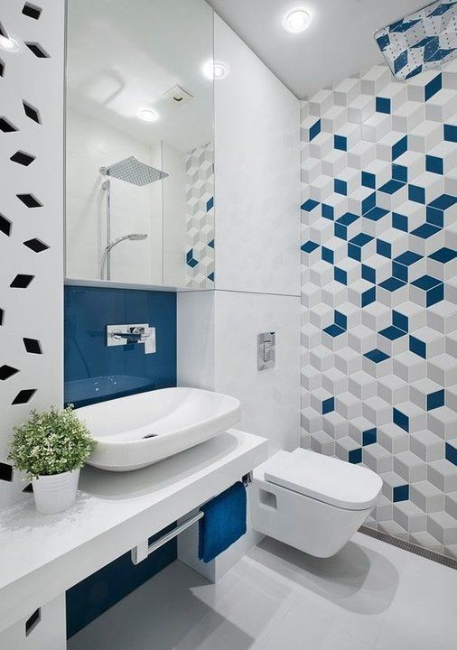 a contemporary bold blue and white bathroom with a geo tile wall, a wall-mounted vanity with white appliances