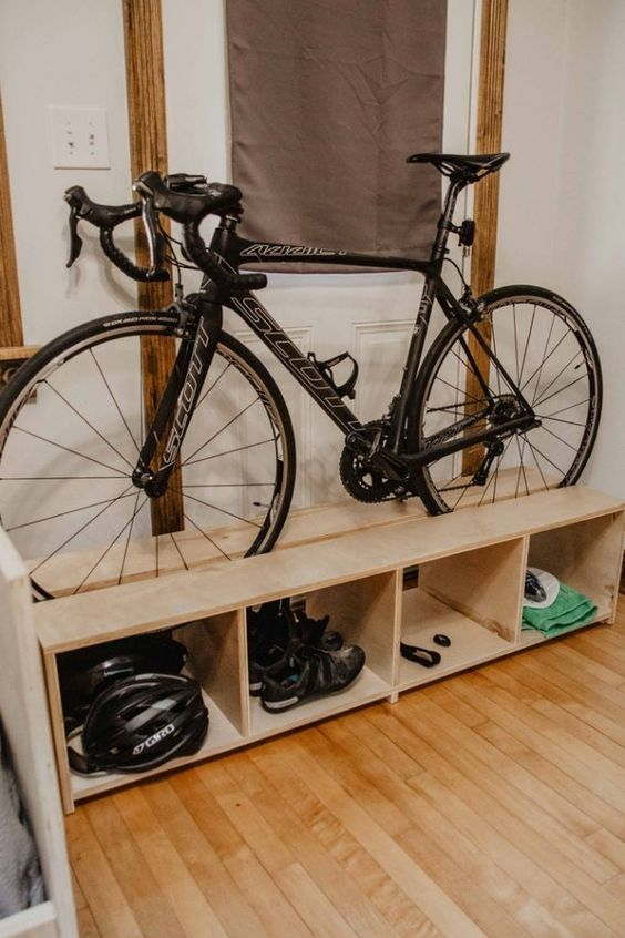 a pallet storage shelf with a bike and various stuff related stored comfortably here is a great idea for a any room